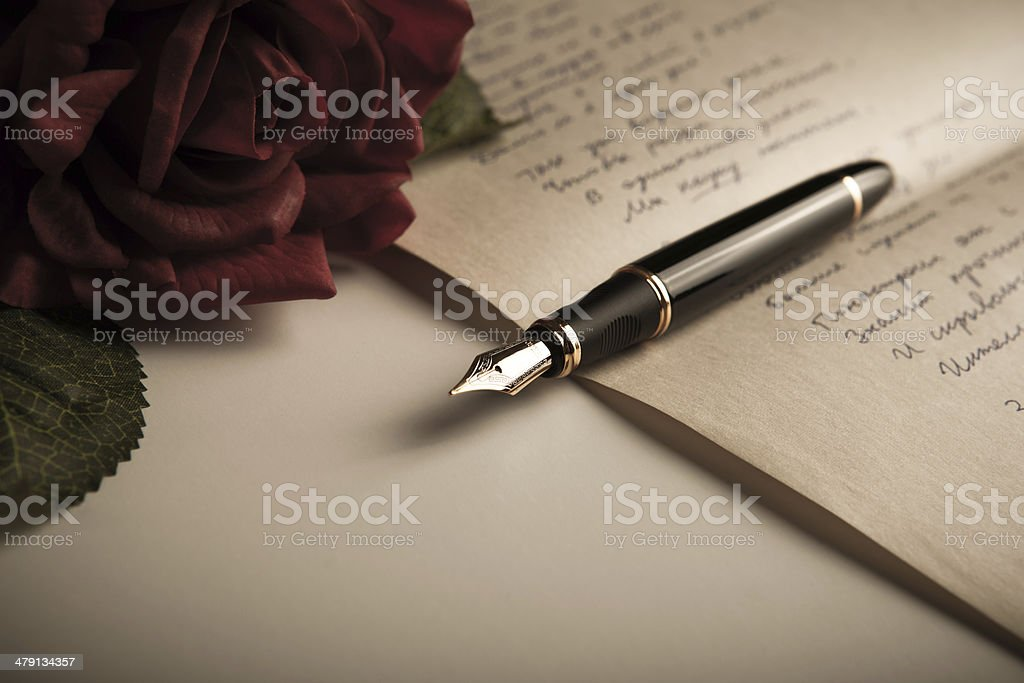 fountain pen on text sheet paper with rose stock photo