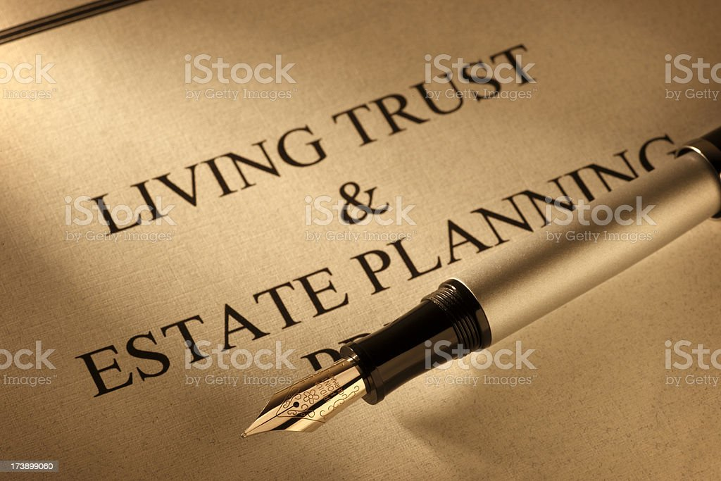 Fountain pen on top of living trust document royalty-free stock photo