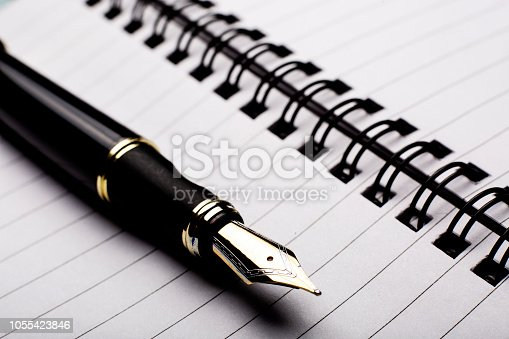 Fountain pen on binder note pad