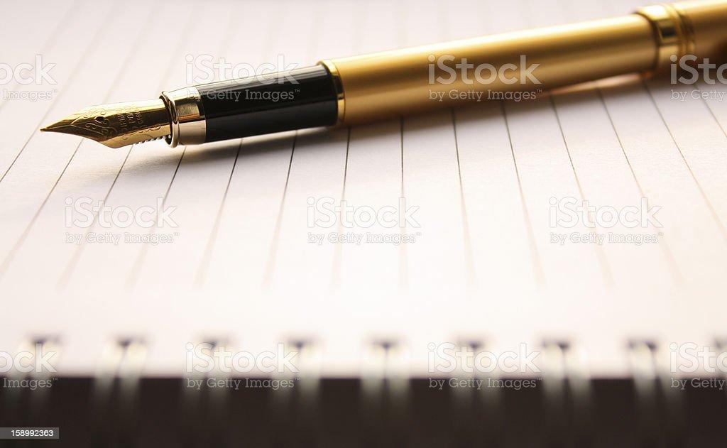 Golden Fountain pen on a notebook