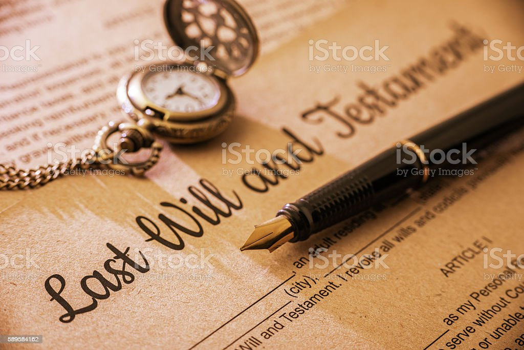 Fountain pen, pocket watch on a last will and testament. stock photo