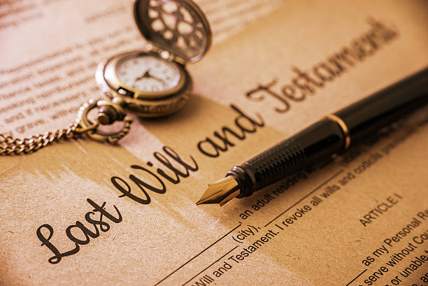 fountain pen, pocket watch on a last will and testament. - stately home stock photos and pictures