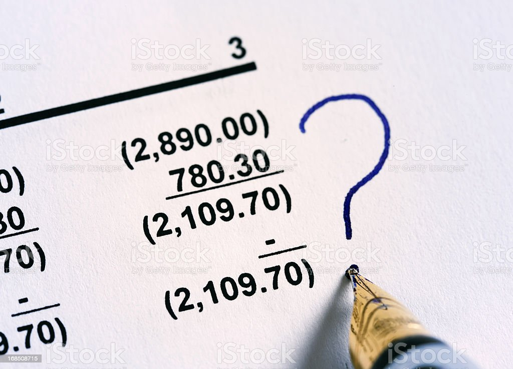 Fountain pen puts question mark by column of numbers. Problems? royalty-free stock photo