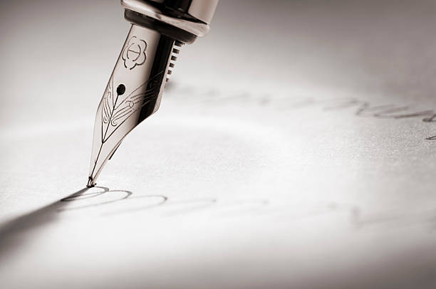 fountain pen writing a signature - pen paper sign bildbanksfoton och bilder