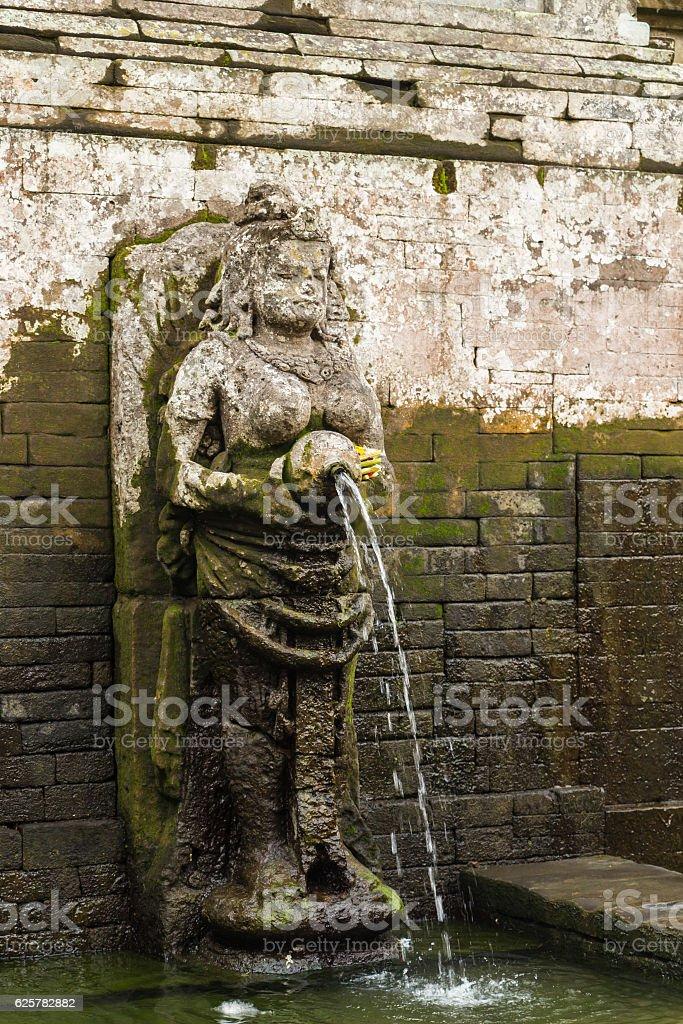 Fountain statue at Goa Gajah Temple, Bali, Indonesia. stock photo