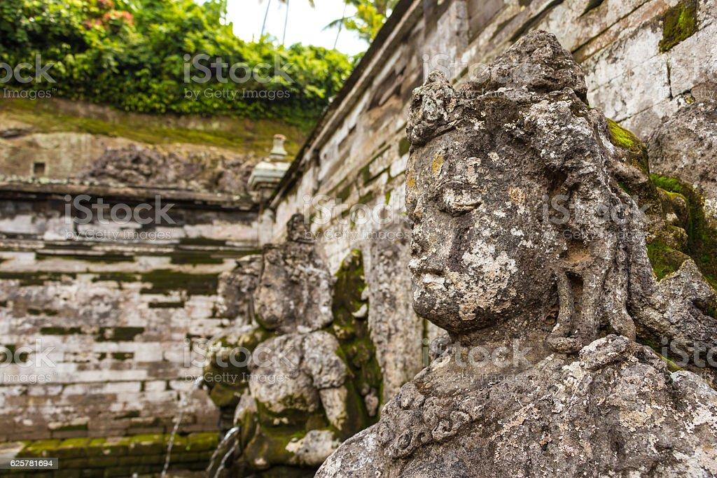 Fountain statues at Goa Gajah Temple, Bali, Indonesia. stock photo