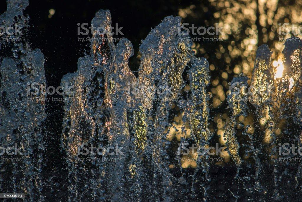 fountain stream at river stock photo