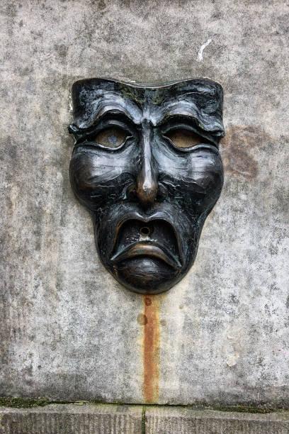 fountain tragedy mask, royal mile, edinburgh, scotland - tragedy mask stock photos and pictures