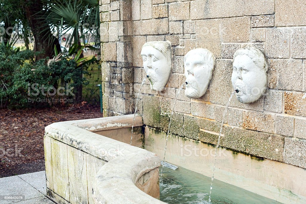 Fountain with faces stock photo