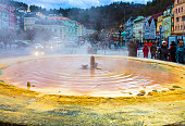 Karlovy Vary, Cszech Republic - January 01, 2018: Fountain with hot springs - the so-called karlovarske vridlo - in the historic centre of Karlovy Vary spa town, Cszech Republic on January 01, 2018 with art-nouveau buildings