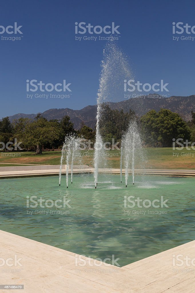 Fountain with mountains in the background stock photo