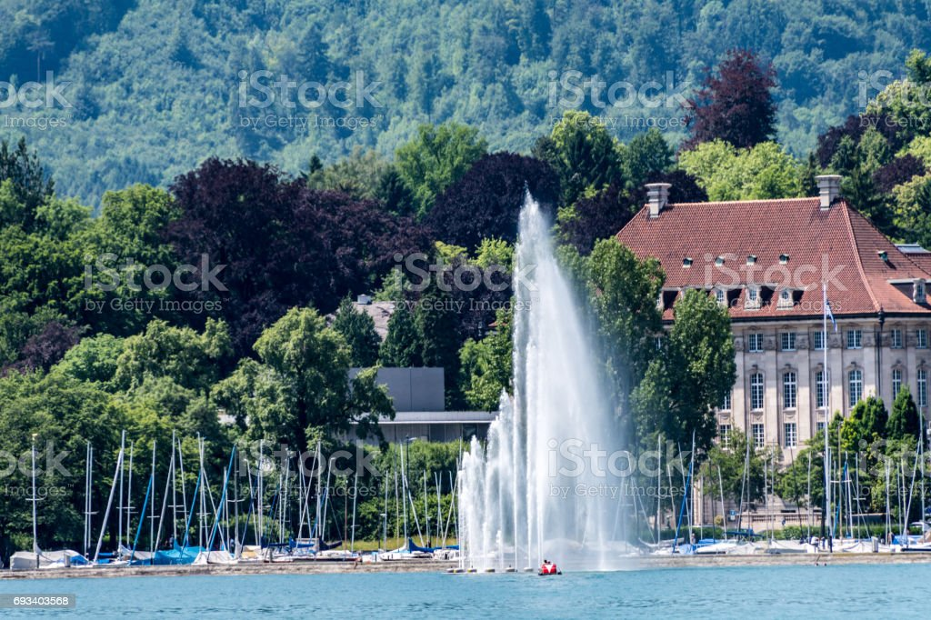Fountains and boats on Lake Zurich stock photo