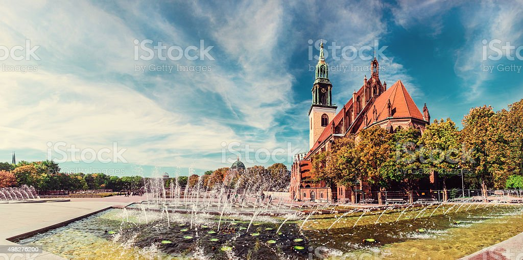 Fountains on Alexanderplatz in front of St. Mary's Church, Berli stock photo