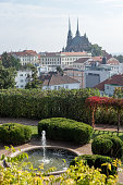 istock Fountains with water in the public park or garden in city. Cathedral of Saints Peter and Paul in Brno in the Czech Republic, Moravia 1284591704