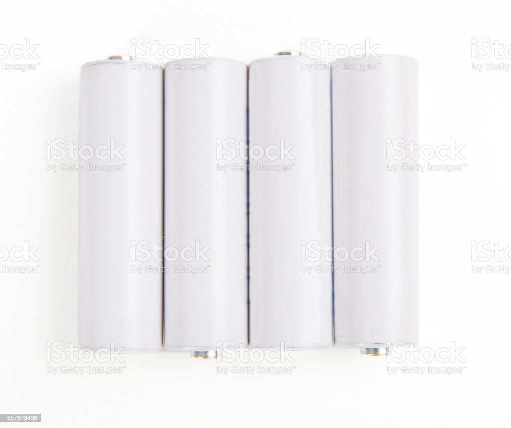 Four aa batteries isolated on white background stock photo