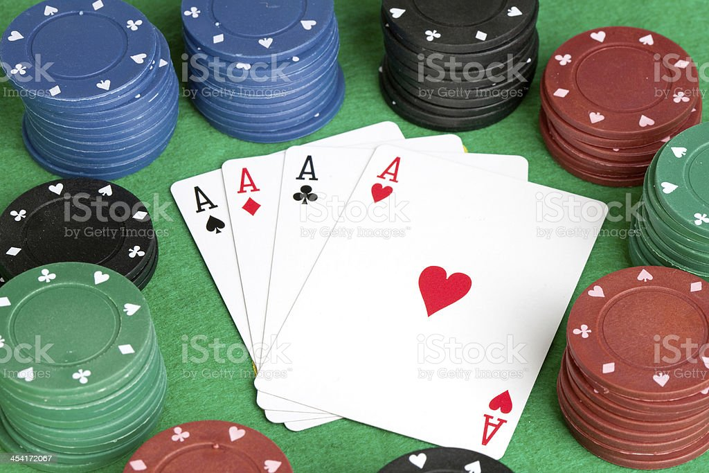 Four aces and poker stacked chips of many colors royalty-free stock photo