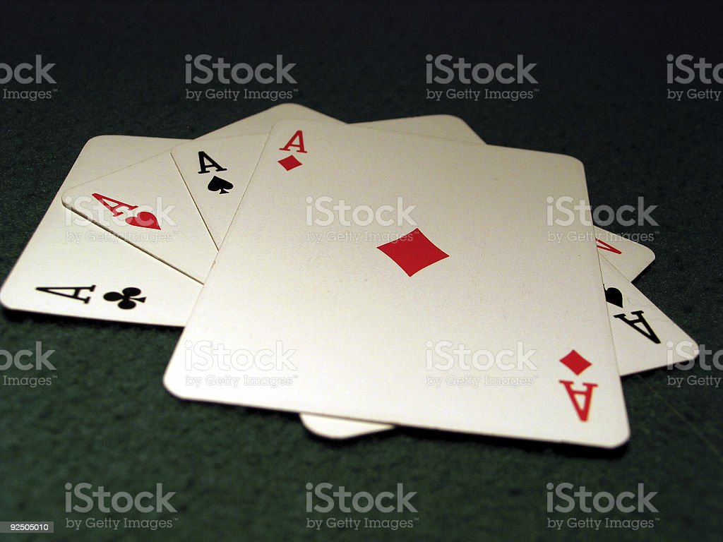 Four aces on green table stock photo