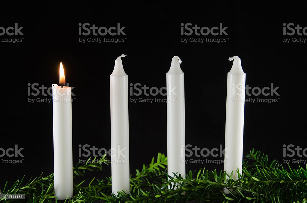 Four advent candles at black background stock photo