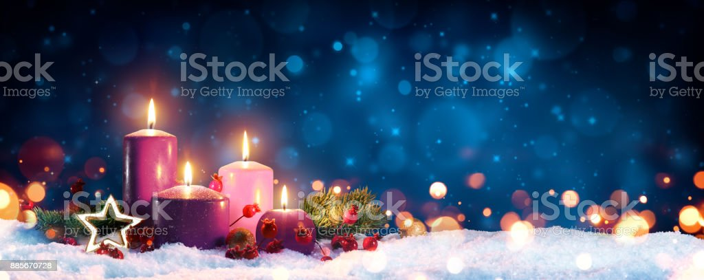 Four Advent Candles In Christmas Wreath On Snow stock photo