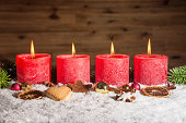 istock Four advent candles lit in snow 619051910