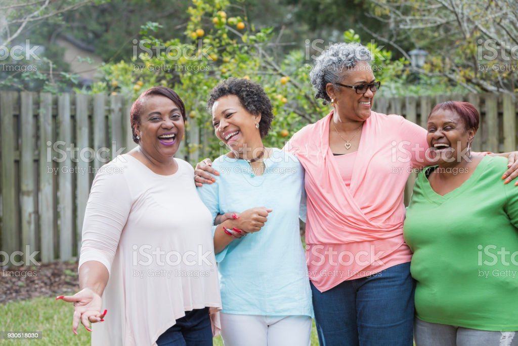 Four African-American women standing outdoors together stock photo
