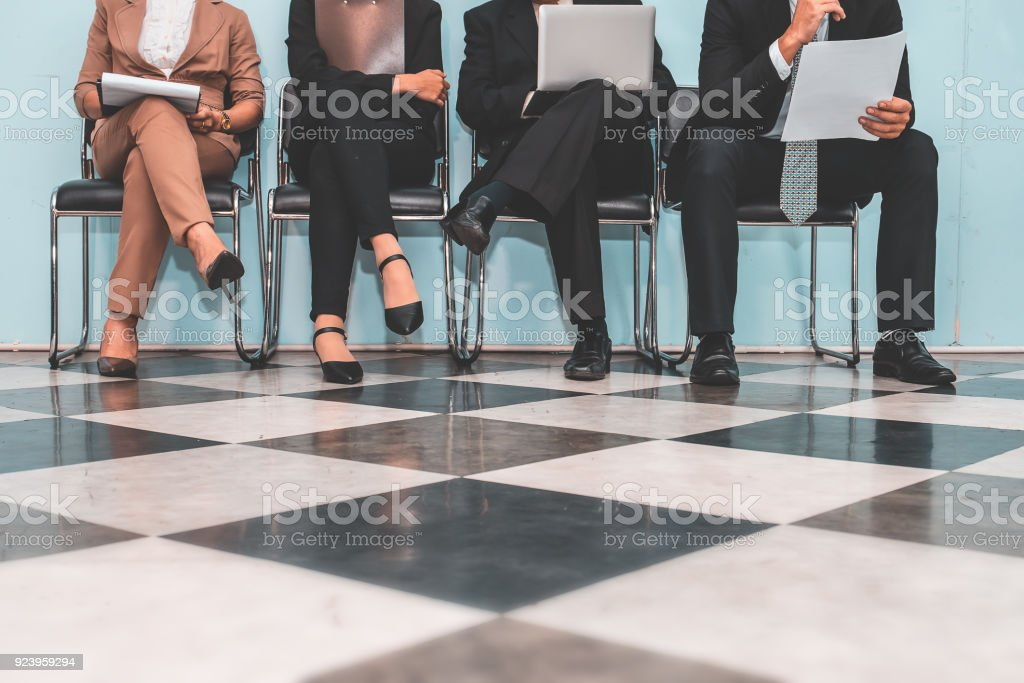 Four applicants  sitting on chairs and preparing for employment interview. royalty-free stock photo