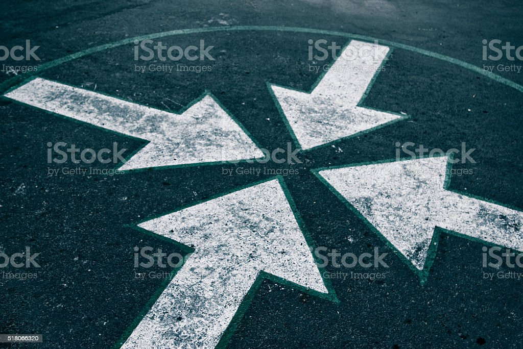 four arrows on asphalt stock photo