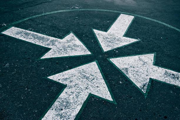 four arrows on asphalt stock photo
