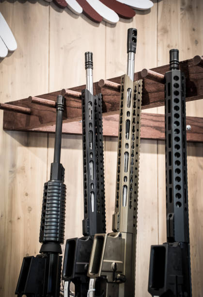 Four Assault Rifles on Gun stand lined up ready for purchase in America faded glory finish Four Assault Rifles on Gun stand lined up ready for purchase in America -  faded glory finish gun shop stock pictures, royalty-free photos & images