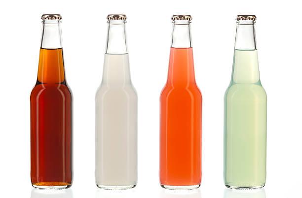 Four assorted soda bottles, alcoholic drinks stock photo