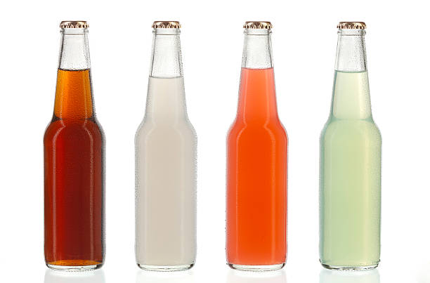Four assorted soda bottles, alcoholic drinks with water drops stock photo