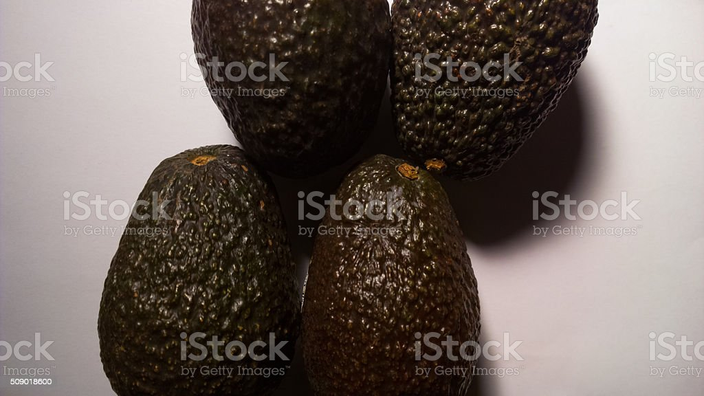 Four Avacados From Above - Horizontal stock photo