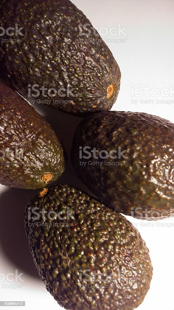 Four Avacados From Above - Vertical stock photo