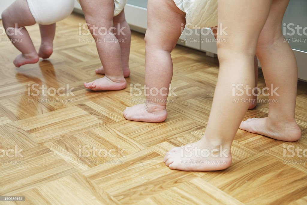 Four babies learning to walk royalty-free stock photo