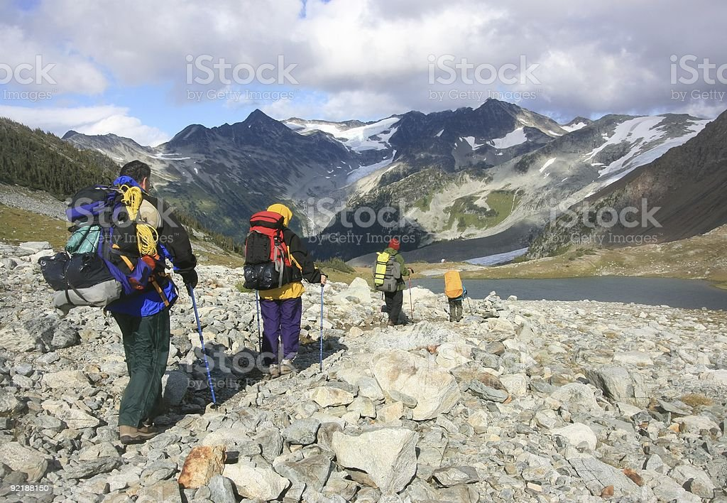 Four Backpackers on the Trail royalty-free stock photo