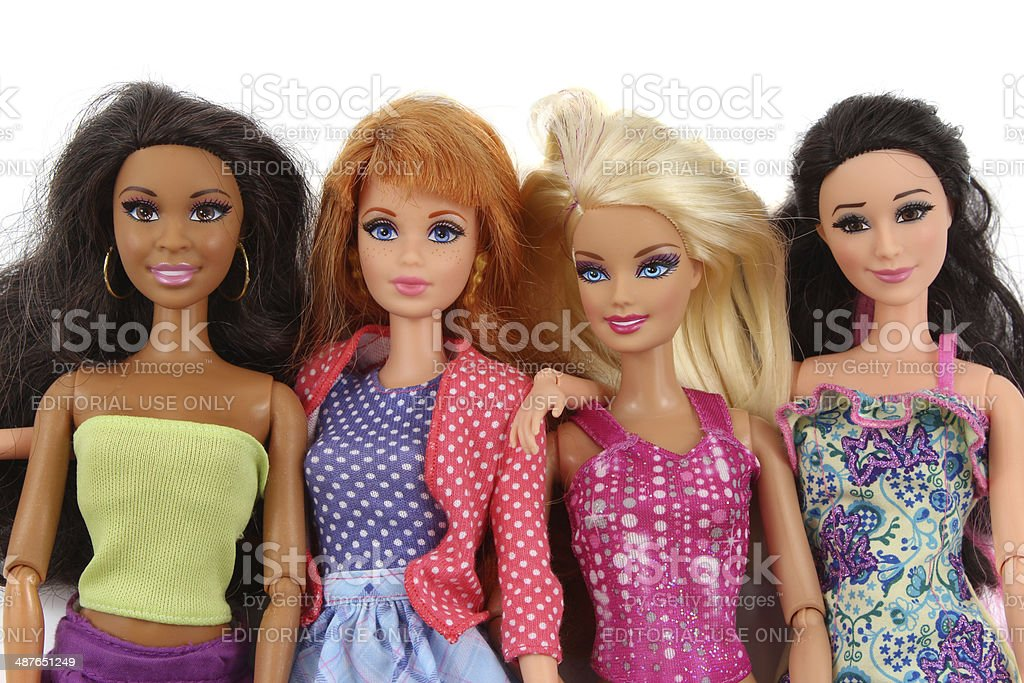 Four Barbie fashion dolls on white background stock photo