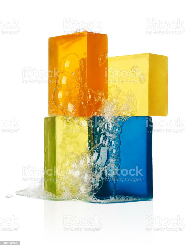 Four bars of sudsy soap on a white background stock photo