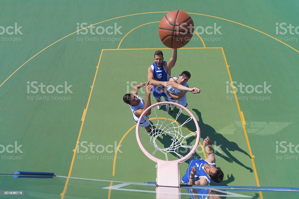 Four Basketball Players in the Action stock photo