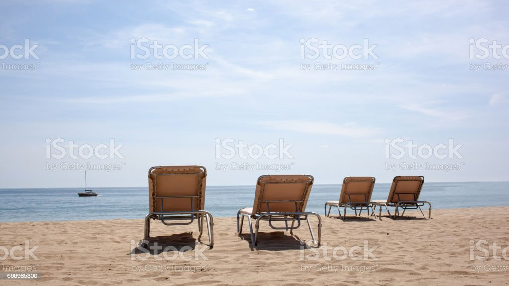 Four Beach Chairs On The Beach Stock Photo Download Image Now Istock