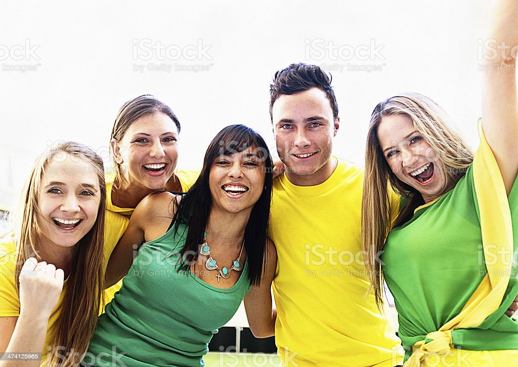 Four beautiful female soccer supporters and one smiling man stock photo