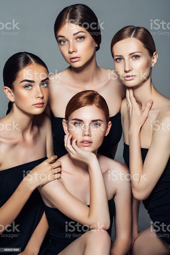 Four beautiful girls with a natural make-up stock photo