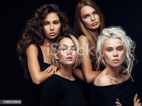 564586660istockphoto Four beautiful girls with make-up and hairstyle 1039202620