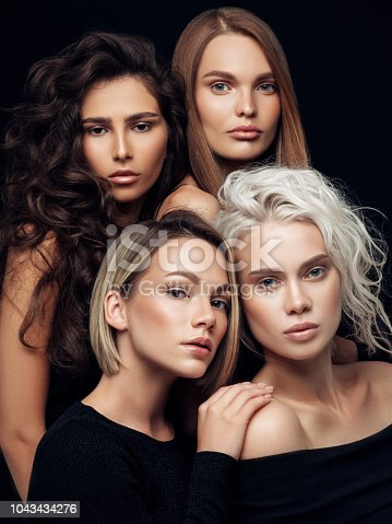 564586660istockphoto Four beautiful girls with make-up and hairstyle 1043434276