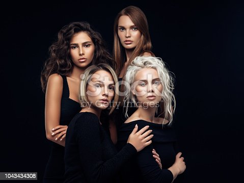 564586660istockphoto Four beautiful girls with make-up and hairstyle 1043434308