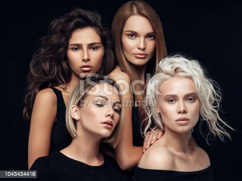 564586660istockphoto Four beautiful girls with make-up and hairstyle 1043434416