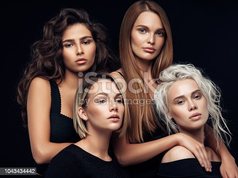 564586660istockphoto Four beautiful girls with make-up and hairstyle 1043434442