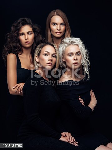 Four beautiful girls with make-up and hairstyle