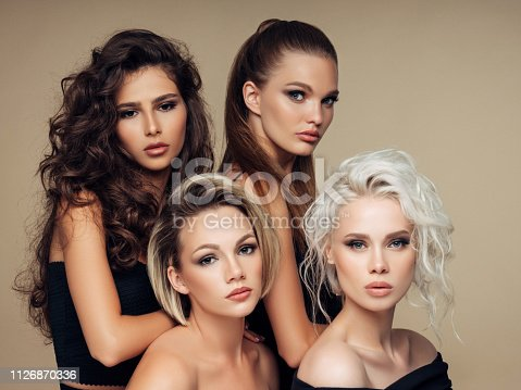 564586660istockphoto Four beautiful girls with make-up and hairstyle 1126870336