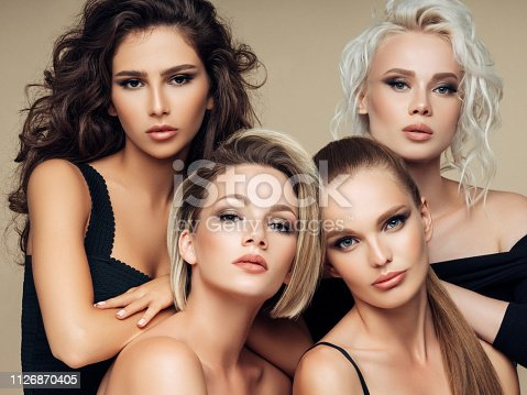 564586660istockphoto Four beautiful girls with make-up and hairstyle 1126870405