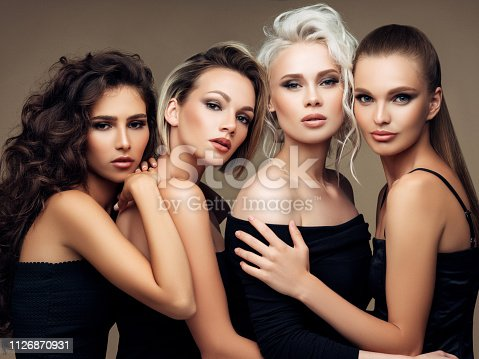 564586660istockphoto Four beautiful girls with make-up and hairstyle 1126870931